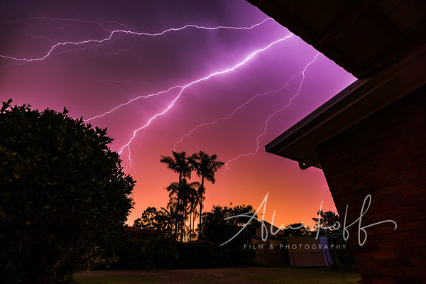Backyard lightning storm during sunset