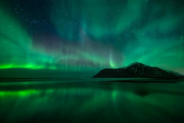 Photo of Aurora Borealis over Skagsanden Beach, Norway