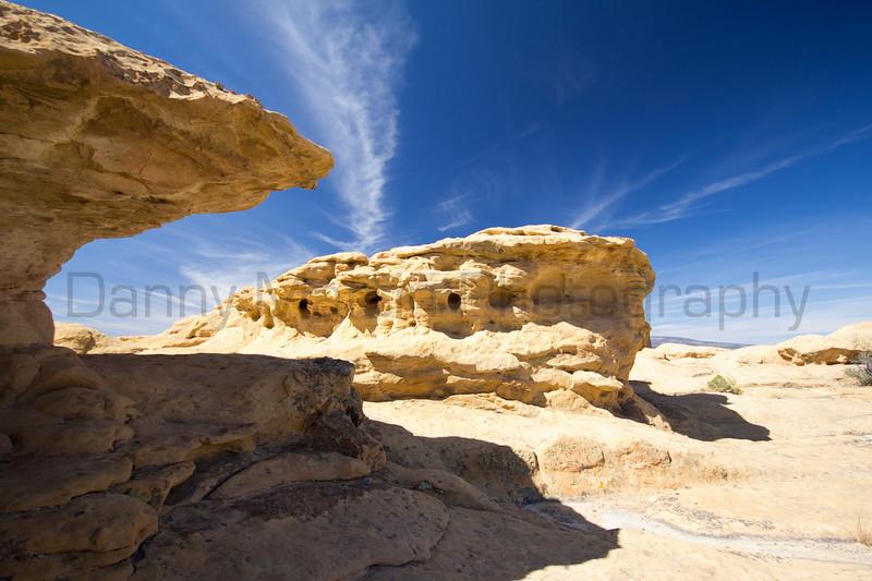 Blue skies and mushroom rock.<br /> El Malpais National Monument, New Mexico.