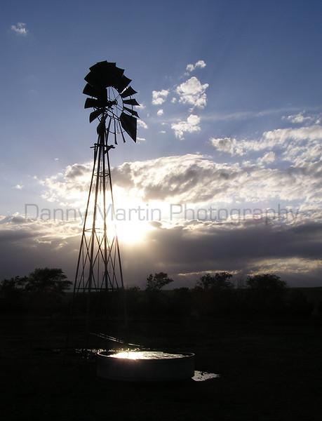 Windmill with late afternoon sun.  <br /> Southwestern Nebraska.