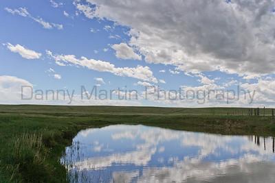 Reflecting the next spring storm.  Pawnee National Grassland, Weld County, Colorado.