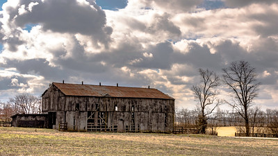 Old, dilapidated barn with dramatic sky