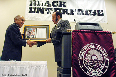 Black Enterprise Magazine Press Conference. The Best 50 Colleges for African Americans. 12/17/02. Morehouse Colleg, Atlanta, Ga. Morehousae is again chosen as #1 again this year. Here Black Enterprise Publisher Earl Graves presents Morehouse College President Dr. Walter Massey with plaque. Photo by Philip McCollum/ Morehouse College