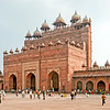 Location: Fatehpur Sikri, India<br /> <br /> From the Lonely Planet: This magnificent fortified ancient city, 40km west of Agra, was the short-lived capital of the Mughal empire between 1572 and 1585, during the reign of Emperor Akbar. Earlier, Akbar had visited the village of Sikri to consult the Sufi saint Shaikh Salim Chishti, who predicted the birth of an heir to the Mughal throne. When the prophecy came true, Akbar built his new capital here, including a stunning mosque, still in use today, and three palaces, one for each of his favourite wives – one a Hindu, one a Muslim and one a Christian (though Hindu villagers in Sikri dispute these claims). The city was an Indo-Islamic masterpiece, but erected in an area that supposedly suffered from water shortages and so was abandoned shortly after Akbar's death.