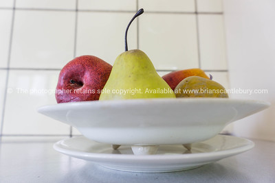 Fruit in art deco style fruit bowl on bench