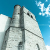 Mediterranean village clock tower rising skyward