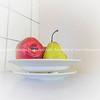 Fruit in white art deco style fruit bowl on bench