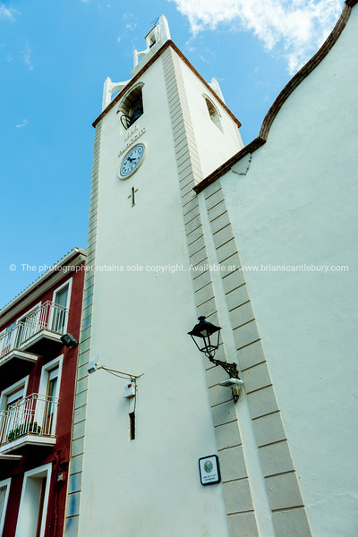 Exterior in monochrome and clock tower Church Holy Virgin, Parcent Spain.