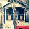 Red car in front vintage effect cottage in Tinakori Street, Wellington