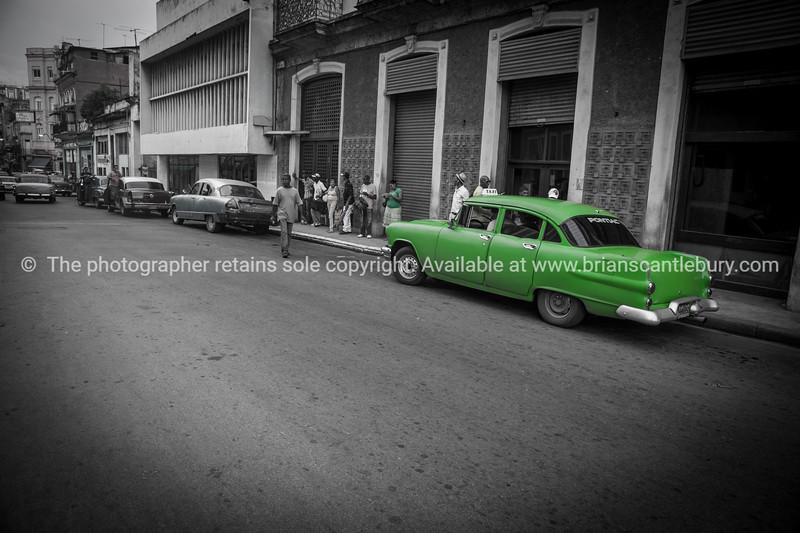 Green Pontiac, classic American car in Havana street in 2013.