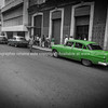 Green Pontiac, classic American car in Havana street in 2013.