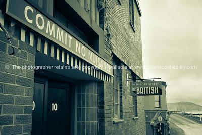 Hotel signs on exterior of old Lyttleton pub