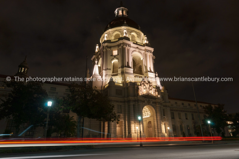Pasadena City Hall, Claifornia, USA, illuminated against dark sky with light trails of passing vehilces.