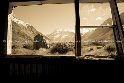 Old image effect. View through trampers hut window to Mount Cook.