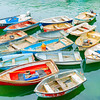 Fleet of rafted up dinghies tied off to pier Mevigissey Cornwall.