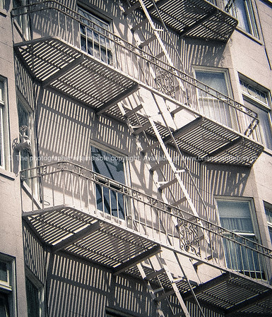 Landings and fire escape stairs pattern the building exterior.