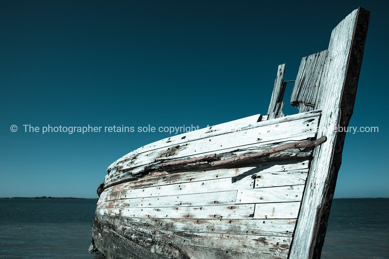 Derelict oyster boat on beach