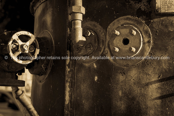 Grungy old steel boiler with fitting close up.