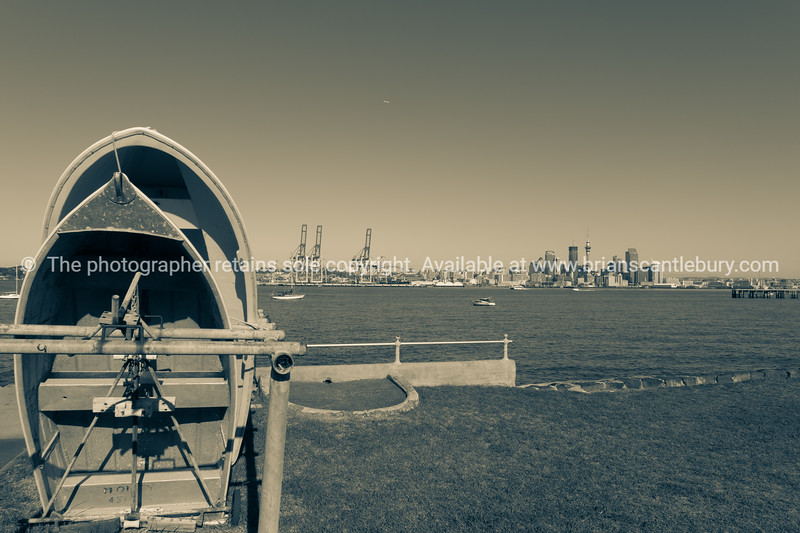Devonport dinghy raks with city skyline in background.