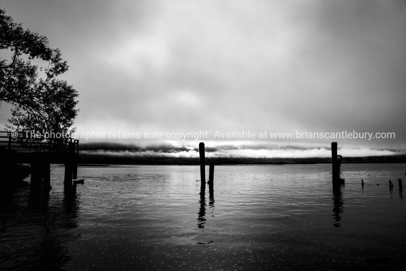Low cloud and light over lake edge