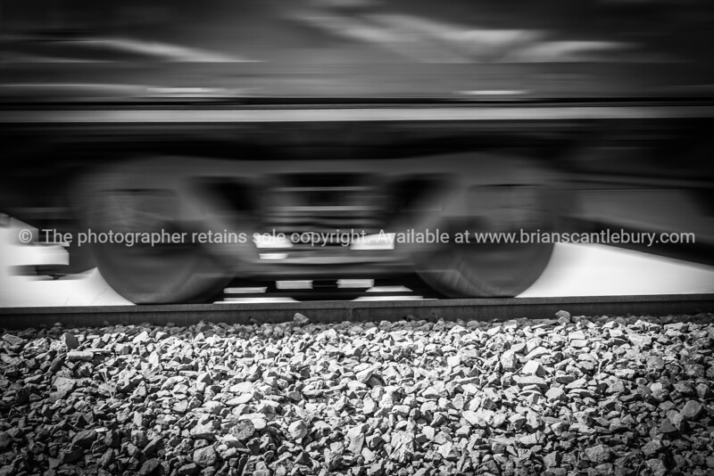 Railway freight carriages pass blurred in motion effect