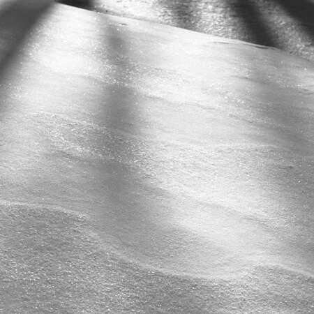 Snow dunes glistening and shadows