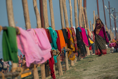 Indian lady monitoring her saree laundry on the banks of the Ganga.NEF