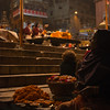 Old Indian lady selling candles and flowers to bless the nightly Puja at Vishwanath Ghat, Varanasi, India.