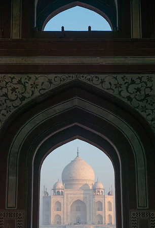 Tal Mahal at Sunrise through the welcome gate.