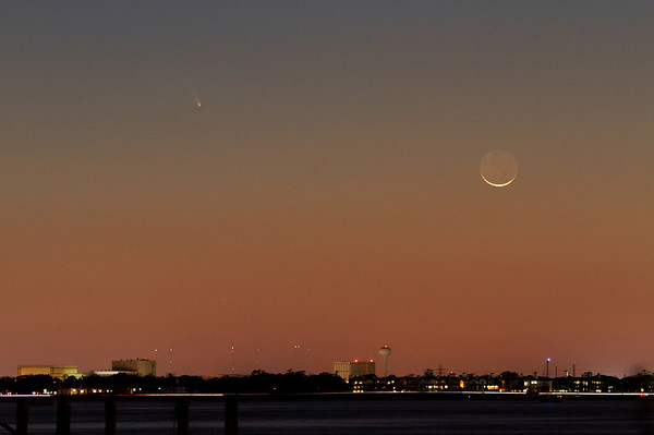 Comet PANSTARRS and thin crescent Moon hang low in the sky over NASA Johnson Space Center