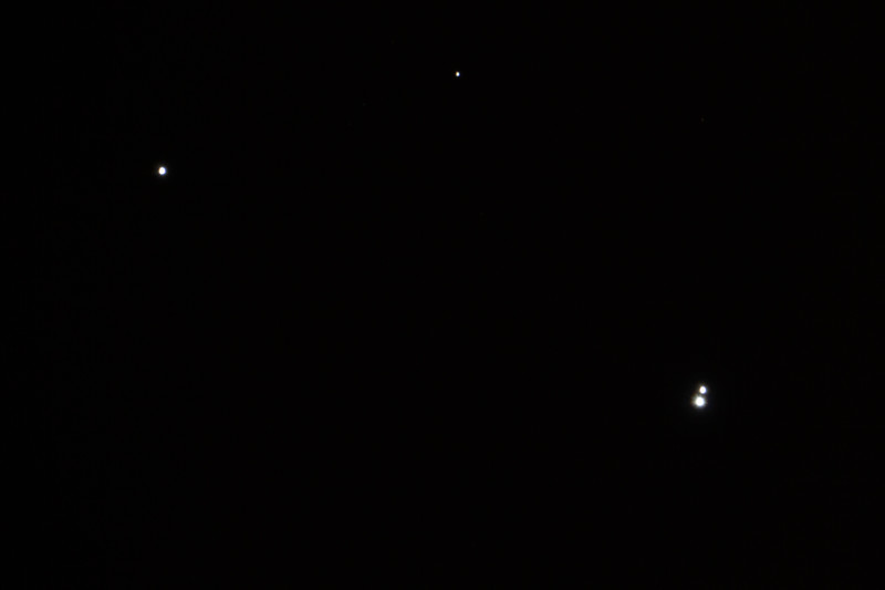Alcor (top left) and Mizar (bottom right two stars), a double star in Ursa Major in the handle of the Big Dipper. Mizar itself is a binary star system.