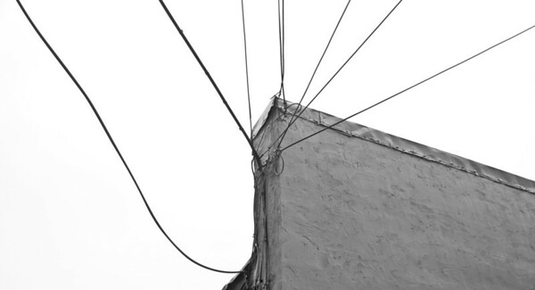 Wire art - electrical wires on corner of building