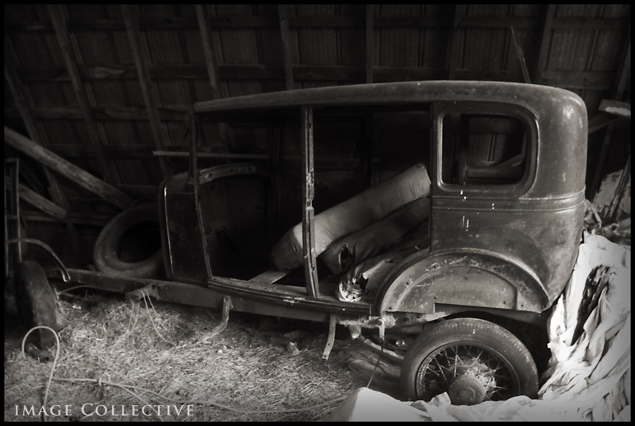 Decaying Model T-Ford in the barn.