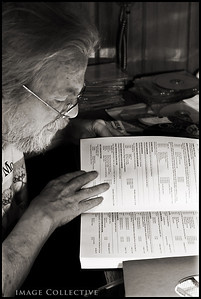 John Coffey looking up a record by Ralph Stanley in his archived catalogue to play.