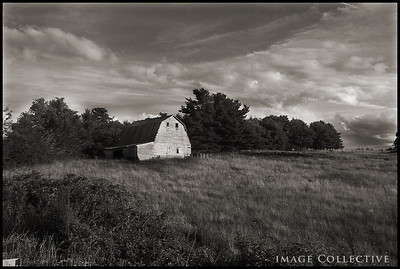 The decaying barn behind the house