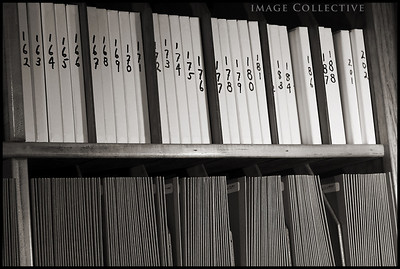 The vast shelves of albums all organized by numbers corresponding to John's catalogue.