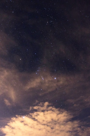Clouds partially obscuring the stars at Gates Pass outside of Tucson, AZ. Orion, Sirius, and Taurus are visible