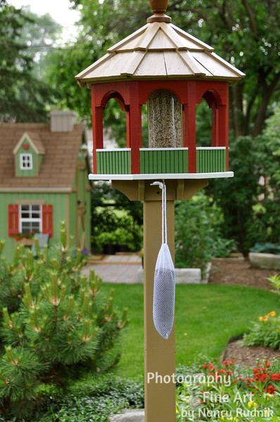 Painted bird feeder to match the playhouse