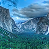 "This was my 5th year coming to Yosemite and I've never made it to the ""Tunnel View"" made famous by Ansel Adams. At about 7pm we drove up Tunnel View hoping to get a sunset shot of El Capitan, Half Dome, and Bridalveil Falls. Unfortunately, the sun/clouds didn't play nice and it just looked kinda gloomy (I was really hoping for a nice red reflection off the rocks). Instead, I brought out the D80 with the 70-300mm lens on it and shot this photo of Half Dome and Bridalveil Falls.<br /> <br /> I was actually surprised by the fact that 70mm (on a DX digital sensor) was too long of a focal length for this scene. Even when I kept backing up and backup up I could *not* get El Capitan, Half Dome, and Bridalveil in the scene. My 35mm lens wasn't quite long enough for what I wanted and I no longer have a lens that goes between 35mm and 70mm. 45mm would have been perfect for this scene"