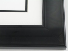 Ted, I would like to recommend a 2 inch gloss black lacquer frame with a double mat, white on top and a black 2nd mat underneath for outline. I think this will give you that modern look.