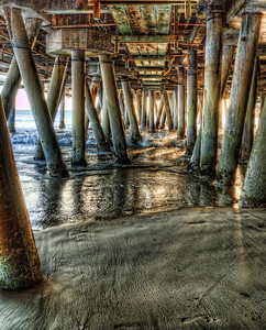 Under the Santa Monica Pier.  California  After you fight off a few bums and horny teenagers, the Santa Monica pier is actually a nice place.