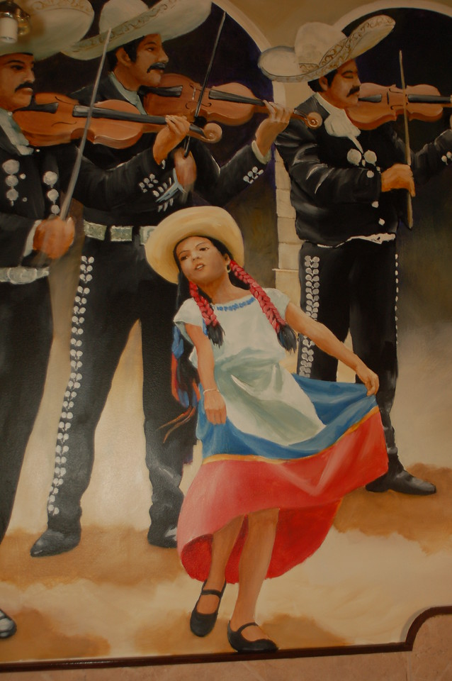 detail from 'festival' wall mural in Mexican rest.