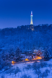 Petrin Tower and hill under snow
