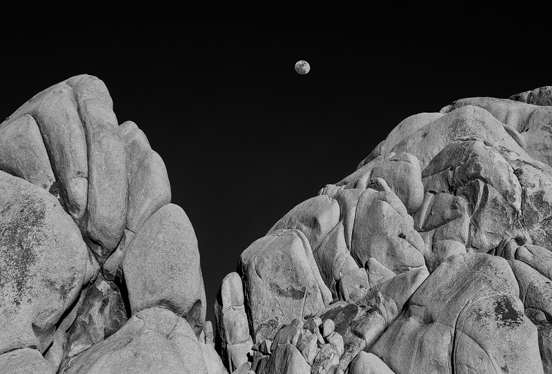 Full Moon Rising Behind Rock Formation