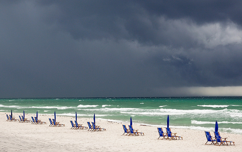 Blue Chairs Under Storm Clouds