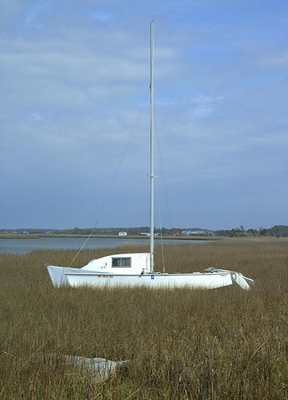A lone sailboat beached at low tide near Morehead NC.