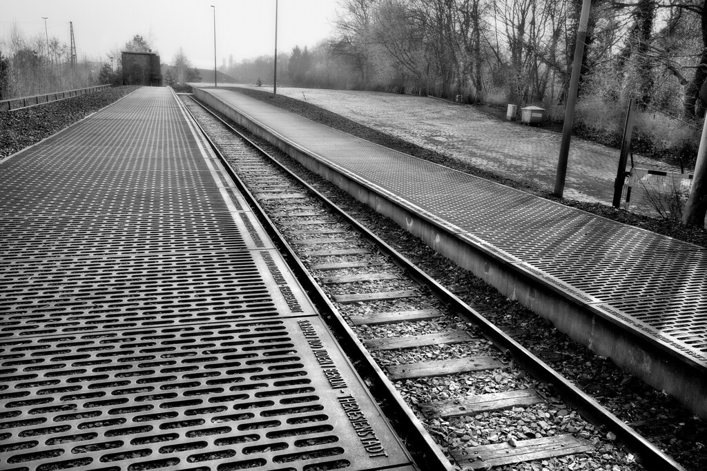 Gleis 17, Berlin-Grunewald Station<br /> <br /> It was not until the 1980's and 1990's that the role of the German Railway in the Holocaust was recognized.  Today, Gleis 17 is a Memorial site.  The track sits undisturbed in every aspect as it vanishes into the distance, and is exactly as it was in those horrific years, except for grasses growing between the rails in one small section near the station itself.  Engraved on the cast iron platforms on each side if the track, are the exact dates and numbers of Berlin Jews deported and the camps to which they were sent from this very spot.  Harsh memories…