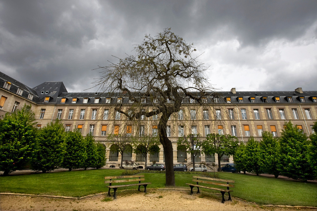 The Hôpital de Bicêtre, which still operates today (Assistance Hôpitaux Publique de Paris) was established in the 17th. century as a hospice for elderly, infirm and insane men.  It also included a prison for much of its history.  Shown here is the Pierre Marie Building.<br /> <br /> Bicêtre is famous for its bold reforms in the treatment of the mentally disturbed.  From 1793 to 1795, the chief physician, Philippe Pinel, ordered the removal of their chains, and moved them out of their dark, dirty cells, thus revolutionizing their care.