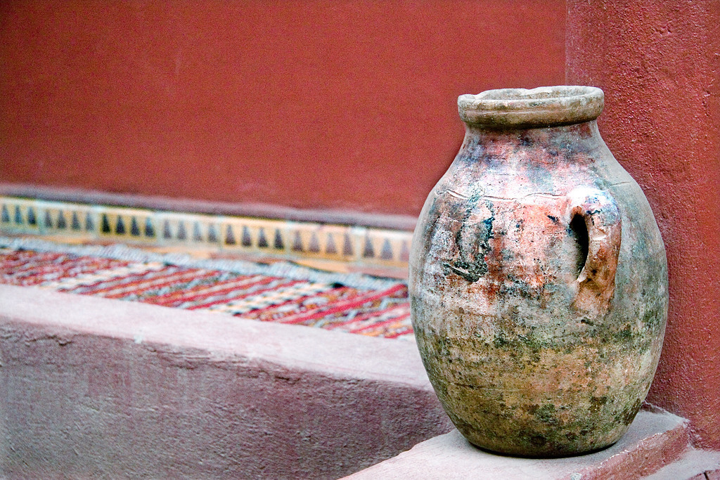 Pottery urn, Ziz Gorge<br /> <br /> The colours in this pottery urn are accentuated by the rich colours of the walls and tapestry.