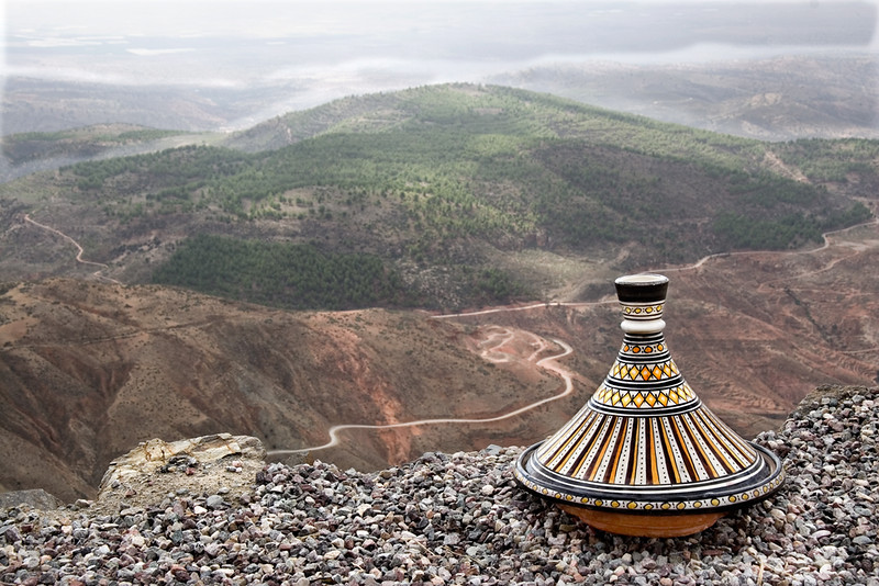 "Tajine at Tiz-n-Test Pass, Middle Atlas<br /> <br /> A tajine is a heavy clay dish , which is sometimes glazed, with a conical cover and is used to serve the ""national dish"" of Morocco, tajine, which takes its name from the vessel.  <br /> <br /> Tajines are usually made with lamb, poultry or fish with vegetables and herbs, prunes, almonds or other ingredients.  They are slow cooked at a low temperature.  There are reputedly as many tagines as there are cooks."